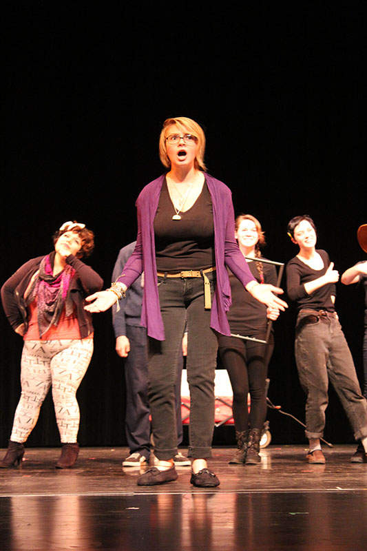 Six Inspire theatre students on stage, working an improv scene.