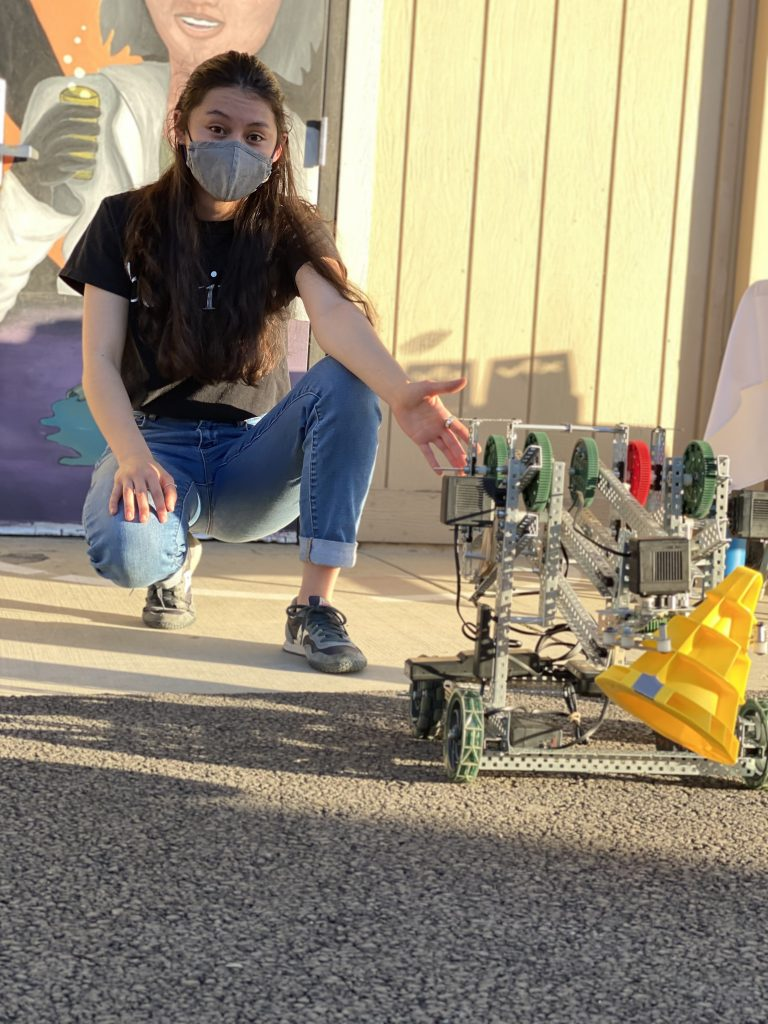 Image of engineering student with robot design
